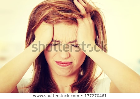 Woman headache, medical symptom of the disease Stock photo © studiostoks