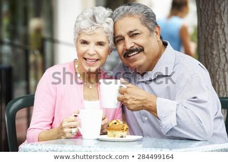 Couple eating pastry in café Stock photo © wavebreak_media