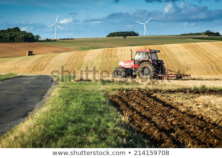 Tractor plowing field and beautiful landscape, France Stock photo © FreeProd