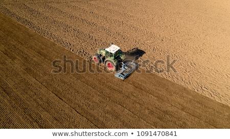 Farmer on tractor plow field, France Stock photo © FreeProd
