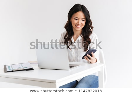 Photo of joyous chinese businesswoman with long dark hair sittin Stock photo © deandrobot