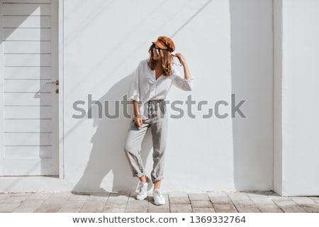 çekici sevimli kız poz gri elbise Stok fotoğraf © fotoduki