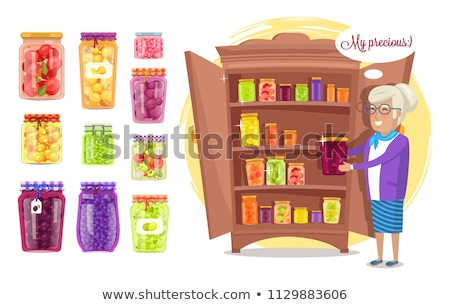 Cheerful Granny with Preserved Food in Cupboard Stock photo © robuart