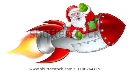 merry christmas santa claus rocket sleigh stock photo © krisdog