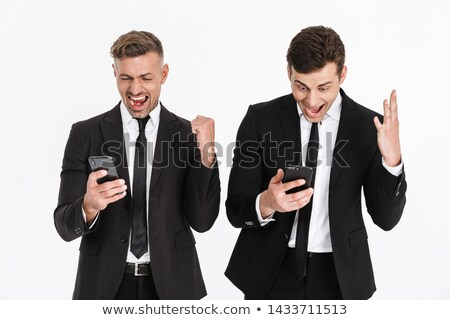 image of delighted businessman 30s in suit screaming while holdi stock photo © deandrobot