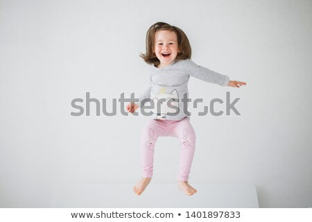 Stock photo: Happy Baby Jumpign for Joy