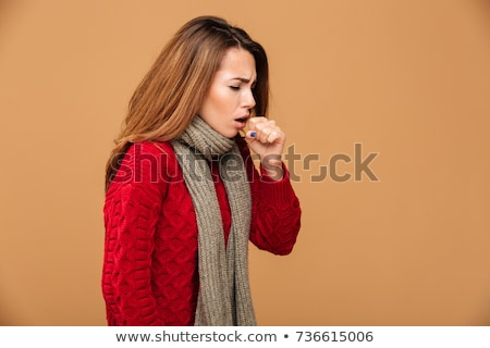 Upset young woman wearing winter scarf Stock photo © deandrobot