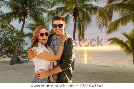 happy couple in sunglasses over tropical beach Stock photo © dolgachov