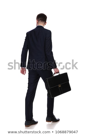happy businessman walks and looks down to side stock photo © feedough