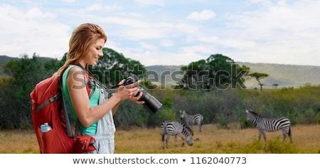 Nő hátizsák kamera szavanna utazás turizmus Stock fotó © dolgachov