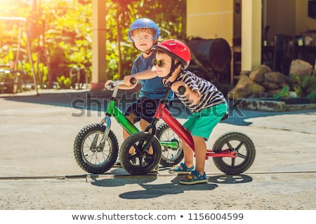 Two little boys children having fun on Balance Bike on a country tropical road Stock photo © galitskaya
