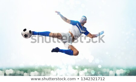 Futebol bola acrobático chutá ar branco Foto stock © alphaspirit