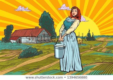 rural woman with a bucket of water or milk farm landscape stock photo © studiostoks