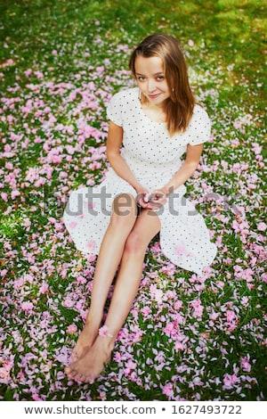 Güzel genç kadın bahçe elbise sakura Stok fotoğraf © ElenaBatkova