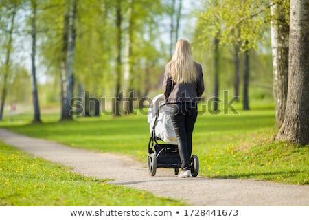 mère · marche · cute · jeune · femme · poussant - photo stock © robuart