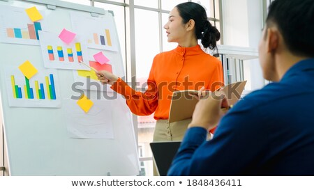 two young businessmen partner explaining information and pointin stock photo © snowing
