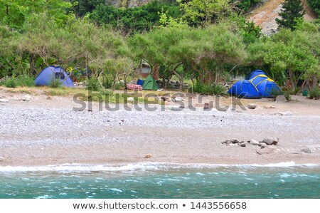 Tractor camping in mediterranean beach camp Stock photo © xbrchx