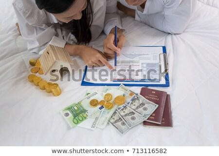 Pár egymásra pakolva érmék fából készült asztal ház Stock fotó © AndreyPopov