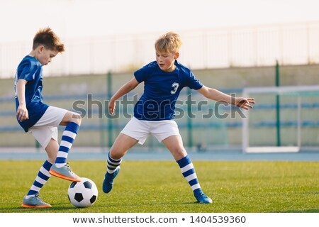 Duel of two young soccer players Stock photo © matimix