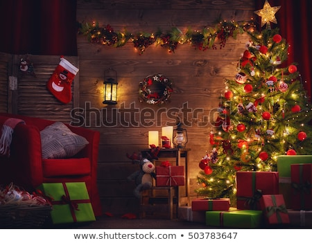 Christmas tree with glowing garlands on background of wooden house of a small town. Sample of poster Stock photo © Lady-Luck