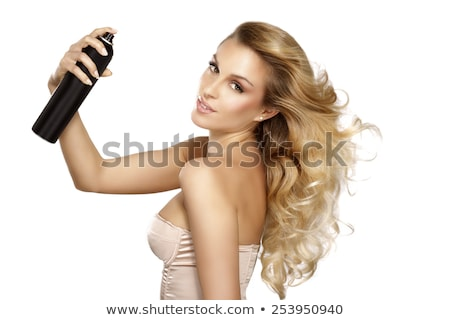 young female hairdresser fixing hair of gorgeous woman with hair stock photo © dashapetrenko