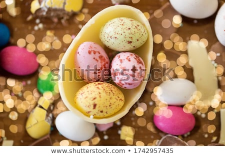 Stock photo: chocolate eggs and candy drops on wooden table