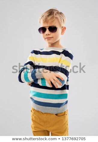 portrait of boy in sunglasses and striped pullover Stock photo © dolgachov