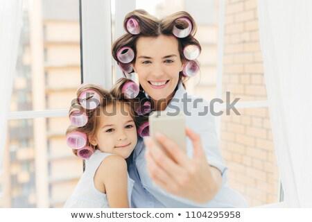 Shot przyjemny patrząc mum córka Zdjęcia stock © vkstudio