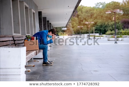 fired sad male office worker leaving Stock photo © dolgachov