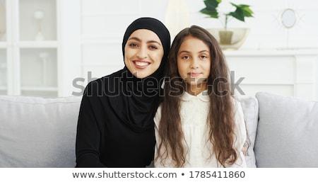 gelukkig · jonge · mooie · vrouw · home · glimlachend · spelen - stockfoto © HASLOO
