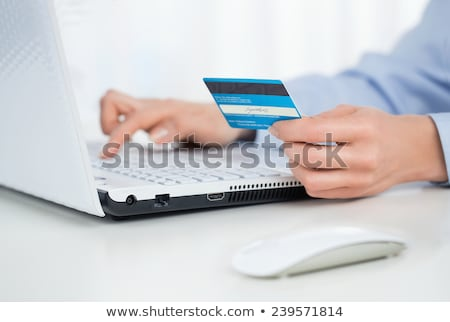 Business woman making payments online using laptop and credit card sitting outdoor at cafe with wire Stock photo © HASLOO