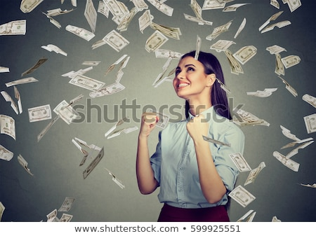 Stock photo: Ecstatic woman with a fistful of money