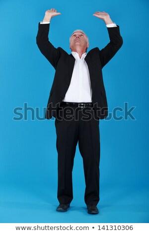 Senior businessman pushing upwards stock photo © photography33
