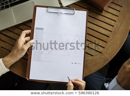 Men writing statistics on paperboard Stock photo © photography33