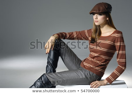 Beauty - lovely young female blonde fashion model sitting stock photo © gromovataya