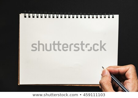 Torn white lined paper page top isolated on black. Stock photo © latent
