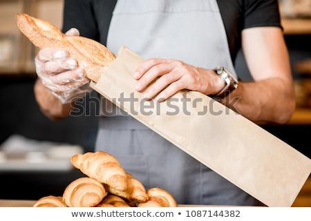 Vender francés baguette mujer mano trabajo Foto stock © photography33