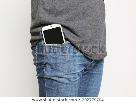 Cellphone in jeans pocket Stock photo © stockyimages