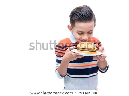portrait of boy holding bun stock photo © zzve