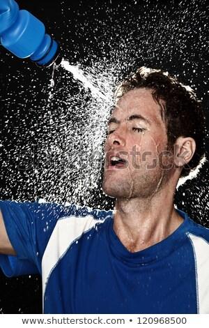 молодым · человеком · питьевой · минеральная · вода · баскетбольная · площадка · воды - Сток-фото © hasloo