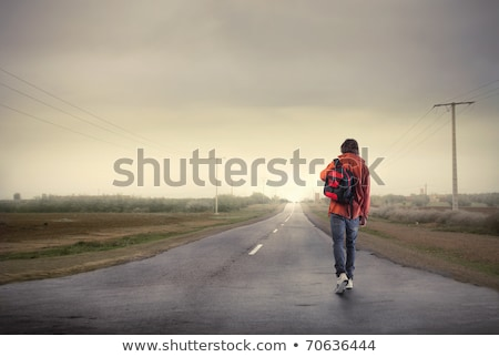 young man walks with bag on road Stock photo © feedough