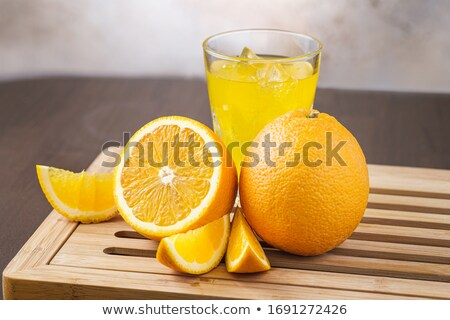 Fizzy glass of iced orange juice up close  Stock photo © nalinratphi