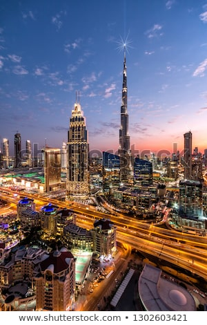 Vertical view of Dubai skyline with blue sky Stock photo © vwalakte