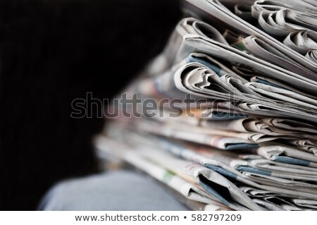 Piled newspapers on a dark background Stock photo © Zerbor