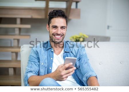 Stock photo: Casual  young man sitting on steps
