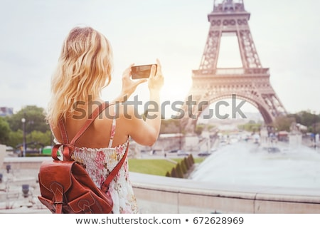 blond tourist girl taking photos with smartphone stock photo © lunamarina