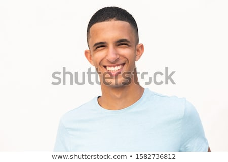 Portrait of young cheerful man stock photo © filipw