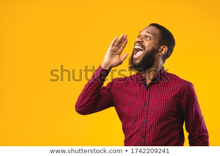 a man holding a megaphone   important announcement stock photo © zerbor