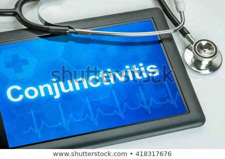 Tablet with the diagnosis conjunctivitis on the display Stock photo © Zerbor