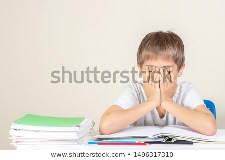 Lehangolt fiatal iskolás fiú tankönyvek hatalmas boglya Stock fotó © ozgur